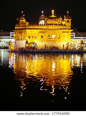 Nightly view of Golden Temple - Sikhs holy place in Amritsar - India - stock photo