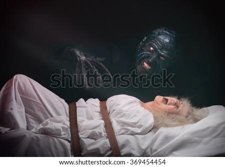 Nightmare. Insane woman and her inner monster - stock photo