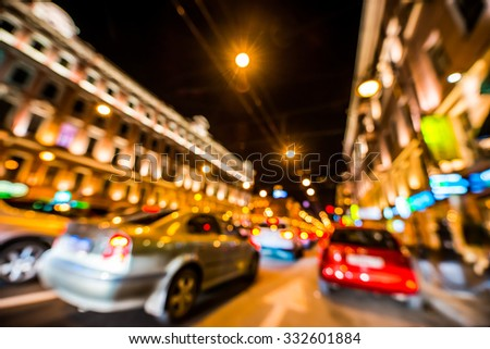 Nights lights of the big city, rush hour in the city. Wide-angle view, defocused image