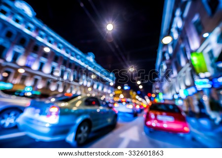 Nights lights of the big city, rush hour in the city. Wide-angle view, defocused image, in blue tones