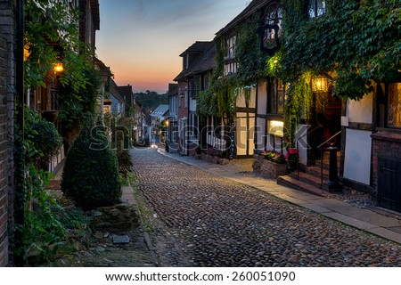 Nighttime on the cobbles at Mermaid Street in East Sussex - stock photo
