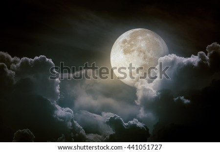 Nighttime sky with clouds and moon. The moon were NOT furnished by NASA.