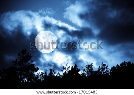 Nighttime sky with moon and clouds and trees silhouettes. Ideal for background. - stock photo
