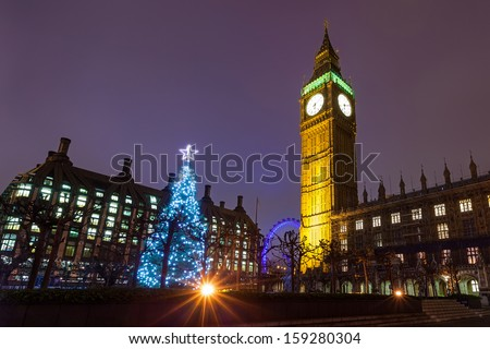 Nighttime View of the Christmas Tree Outside the Palace of Westminster in London, England. - stock photo