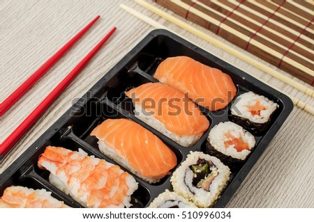 nigiri sushi in a black plastic box
