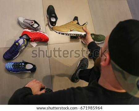Nike store. Man buys sneakers Nike Air Max - Ukraine, Kiev - June 20, 2017