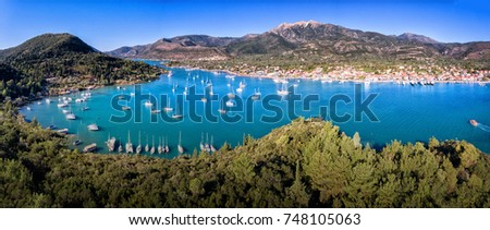 Nikiana (Nidri) bay panorama Lefkada Greece with yachts and clear blue water in the summer