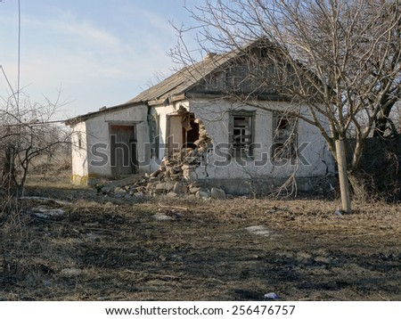 NIKISINO, UKRAINE - Feb 27, 2015: Ruined house. Village Nikishino located 20 km from Debaltseve, Ukrainian military was abandoned three days ago. Separatist forces attacked it for several days.
