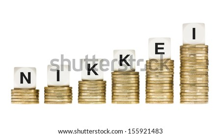 NIKKEI (Tokyo Stock Exchange Share Index) on Gold Coin Stacks Isolated on White