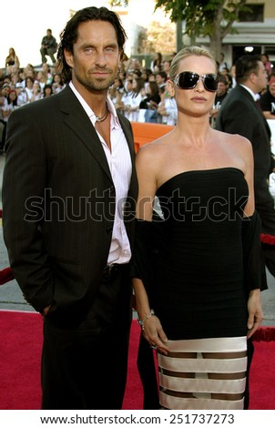 "Niklas Soderblom and Nicollette Sheridan attend the Los Angeles Premiere of ""Mr. & Mrs. Smith"" held at the Mann's Village Theater in Westwood, California on June 7, 2005."