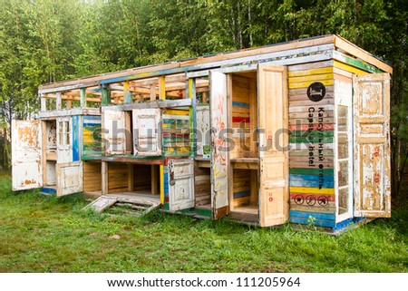 NIKOLA-LENIVEC, RUSSIA- AUGUST 12: Russian version of a capsule hotel: in Russian landscape and with Russian flavour on August 12, 2012 in Nikola-Lenivets. Absolutely new vision of wood sculpture.