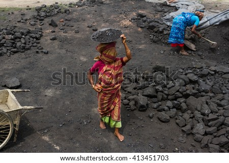 NILPHAMARI, BANGLADESH - APRIL 23, 2016: Old female laborer is working near the coal chamber of a brick field at Saidpur.