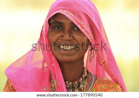 NIMAJ BAGH, INDIA � FEBRUARY 28: An unidentified woman inside the village of Nimaj Bagh, Rajasthan, Northern India on FEBRUARY 28, 2012. The village has just been opened up to boutique tourism. - stock photo