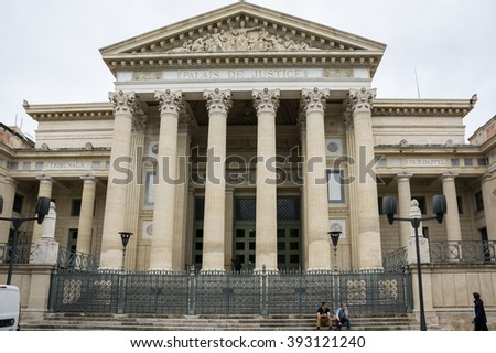 NIMES, FRANCE - MAY 04, 2015: Palace of Justice in Nimes. Nimes is a famous and very popular among tourists city in Provence in south of France