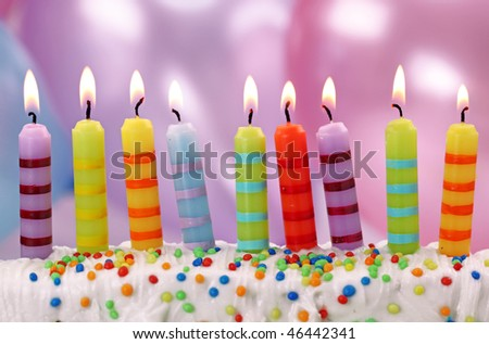 Nine birthday candles on lilac background