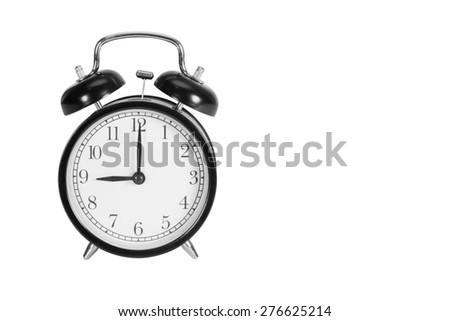 Nine O' Clock on alarm clock isolated on white - stock photo