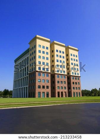 Nine Story Modern Office Building with Blue Sky - stock photo