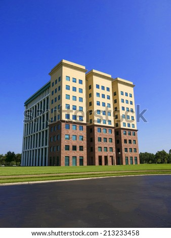 Nine Story Mordern Office Building with Blue Sky - stock photo