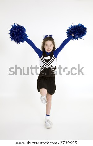 Nine year old Caucasian girl dressed in a blue cheerleader outfit isolated on a white background