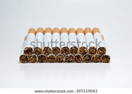 Nineteen cigarettes on a white background. Row of cigarettes. Stacked cigarettes. Isolated cigarettes. Cigarette tobacco.