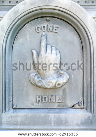 Nineteenth century gravestone detail gone home hand pointing - stock photo
