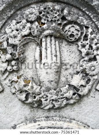 Nineteenth century gravestone hand and wreath - stock photo