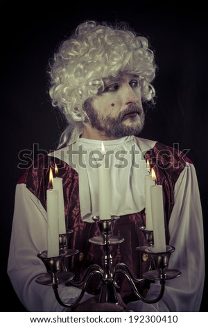 nineteenth century man, , chandelier with candles - stock photo