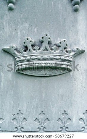 Nineteenth century tombstone detail crown bas-relief - stock photo