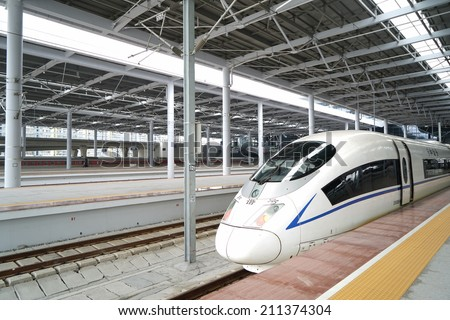 Ningbo, CHINA - August 16: High speed train departure on August 16, 2014 in Ningbo,China.China has the world's longest high speed rail network (over 9,300 km).