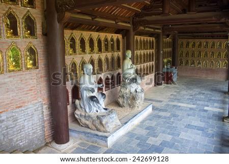 NINH BINH, VIETNAM - AUG 2, 2012: Buddha images in Bai Dinh temple near Ninh Binh, Vietnam - stock photo