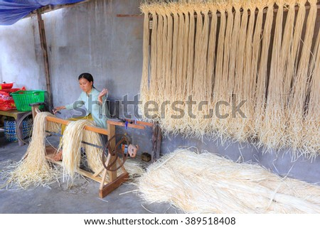 Ninh Thuan Province, Vietnam - February 27, 2016: at a craft village in Ninh Thuan province. Vietnam. A women weave the ropes from many papyrus fibers