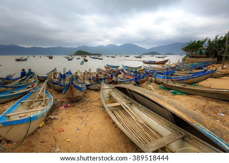 Ninh Thuan Province, Vietnam - February 27, 2016: Boats at anchor at a fishing village in Ninh Thuan coast with cloudy weather