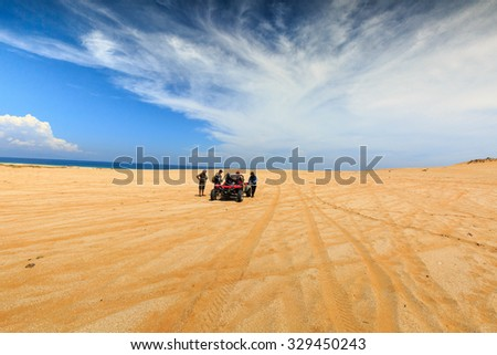 Ninh Thuan province, Vietnam - June 11, 2015: A group of tourists prepared to explore the sand dunes at Mui Dinh the seaside, Binh Thuan Province by coach terrain vehicles