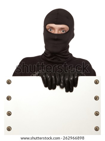 Ninja. Robber hiding behind a empty white sign with space for text. Isolated on white background - stock photo