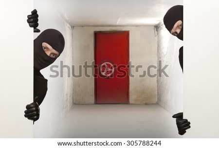 Ninja. Safe. Robber hiding behind a empty white sign with space for text - stock photo