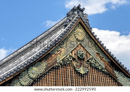 Ninomaru Palace rooftop at Kyoto Nijo Castle in Kyoto, Japan.� The castle consists of two concentric rings of fortifications, the Ninomaru Palace, the ruins of the Honmaru Palace and several gardens. - stock photo