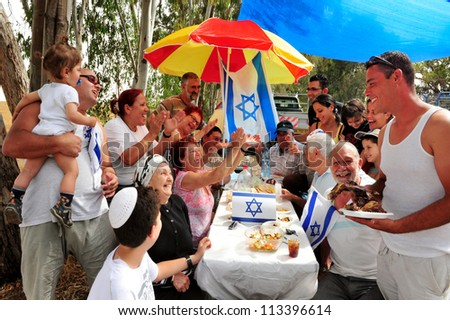 NIR AM - APRIL 20:Israeli family riding during a picnic enjoying Israel's Independence day celebrations on April 20 2010 in Nir Am, Israel. - stock photo