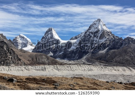 Nirekha (6169 m), Kangchung (6062 m), and Chola (6069 m) in the area of Cho Oyu - Gokyo, Nepal, Himalayas - stock photo