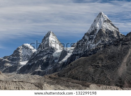 Nirekha (6169 m), Kangchung (6062 m), and Chola (6069 m) in the area of Cho Oyu - Gokyo region, Nepal, Himalayas - stock photo
