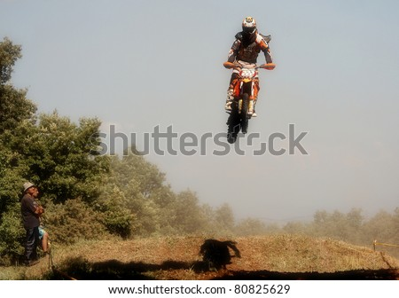 NISH, SERBIA - JUNE 19: Unknown rider participates at the Open Championship of Serbia in motocross, June 19, 2011 in Nish, Serbia - stock photo