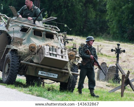 NITRA, SLOVAK REPUBLIC - JUNE 15: Reconstruction of the Second World War operations between Red army and German army, german motorized unit during survey on June 15, 2013 in Nitra, Slovak Republic