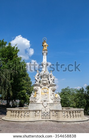 Nitra, Slovakia - August 6, 2015: View of the plague column and castle in Nitra, Slovakia. It was erected in 1750 and made by the artist Martin Vogerle to commemorate major black death epidemics.