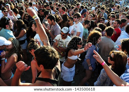 NITZANIM, ISR - APR 10:Israeli youth in Boombamela festival on April 10 2009.It's a Shanti/New Age festival held annually in Israel since 1999 based on the Hindu festival of Kumbh Mela in India. - stock photo