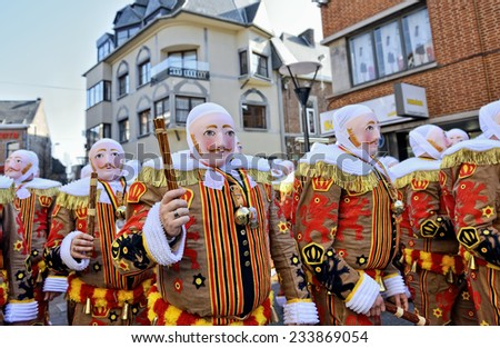 NIVELLES, BELGIUM-MARCH 09, 2014: Gilles De Binche in traditional masks during carnival defile in Nivelles.