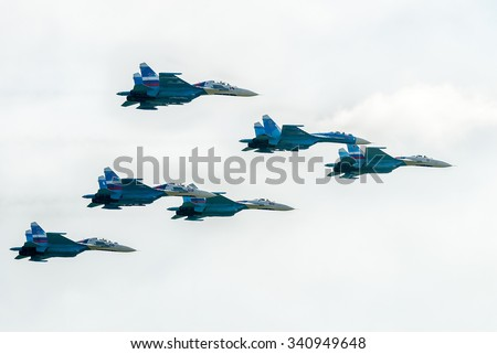 Nizhniy Tagil, Russia - July 12. 2008: fighters SU-27 display of fighting opportunities of equipment with application of aviation means of defeat. RAE exhibition. Russia Arms Expo - stock photo