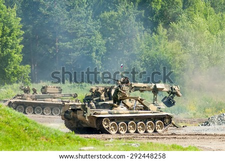 Nizhniy Tagil, Russia - July 12. 2008: Obstacle remover IMR-2MA and bridge layer MTU-72 and engineering vehicle move, Display of fighting opportunities of arms and military equipment. RAE exhibition - stock photo