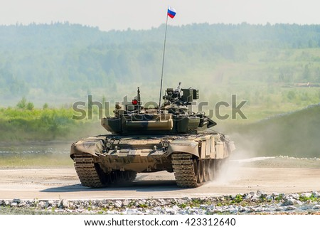 Nizhniy Tagil, Russia - July 12. 2008: Shooting tank T-80s moving through cross-country terrain with obstacles. Display of fighting opportunities of arms and military equipment. RAE exhibition - stock photo