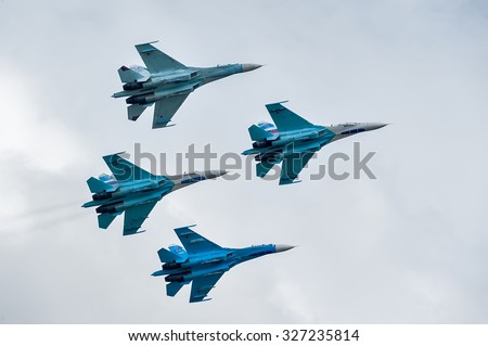 Nizhniy Tagil, Russia - September 25. 2013: Group flight of russian highest pilotage team on SU-27. Display of fighting opportunities of equipment with application of aviation means of defeat - stock photo