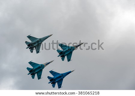 Nizhniy Tagil, Russia - September 25. 2013: Team flight of russian highest pilotage team on SU-27. Display of fighting opportunities of equipment with application of aviation means of defeat - stock photo
