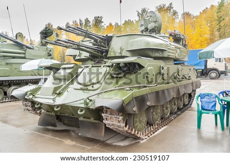 Nizhniy Tagil, Russia - September 26. 2013: Visitors examine military equipment on exhibition range. Antiaircraft gun missile system ZSU-23-4M4 Shilka-M4. Russia Arms Expo-2013